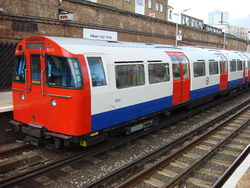 A Bakerloo Line train unusually at Overground station Kilburn High Road before going to Queens Park & continuing to Harrow & Wealdstone