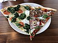 2019-06-20 16 13 19 A slice of vegetable pizza and a slice of deluxe pizza at a Mamma Lucia Pizzaria in Silver Spring, Montgomery County, Maryland.jpg