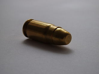 .357 SIG - Oblique view of a .357 SIG FMJ cartridge.
