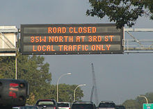 overhead road closed sign over freeway
