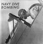 A-pilot-siting-in-airplane-diving-for-bombing-391749538496.jpg