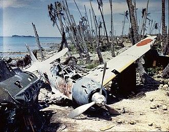 Mitsubishi A6M Zero - Mitsubishi A6M3 Zero wreck abandoned at Munda Airfield, Central Solomons, 1943