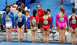 Gymnastics at the 2008 Summer Olympics - The group of top six AA female qualifiers face the judges before the start of competition.