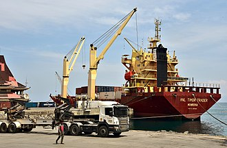 Transport in East Timor - General cargo ship ANL Timor Trader being unloaded at Dili, 2018