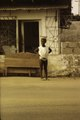 ASC Leiden - F. van der Kraaij Collection - 01 - 023 - A scantily clad young girl in the street carrying a plate with food on her head - Monrovia, Old Road, Montserrado County, Liberia, 1976.tiff