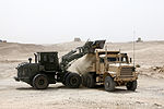 A U.S. Marine Corps tractor dumps sand into a medium tactical vehicle replacement at Camp Bastion, Helmand province, Afghanistan, Aug. 7, 2013 130807-M-SA716-124.jpg