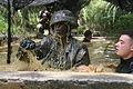 A U.S. Marine splashes as he makes his way through an obstacle course at the Jungle Warfare Training Center on Camp Gonsalves, Okinawa, Japan, Aug. 21, 2009 090821-M-WA483-144.jpg