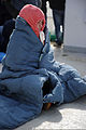 A detained role player tries to stay warm during a boarding of R-V Strait Hunter, which was simulating a migrant vessel, May 8, 2012, in Sydney, Nova Scotia, Canada, during exercise Frontier Sentinel 2012 120508-N-IL267-077.jpg
