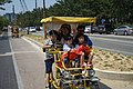 A family on a four seater bike.jpg