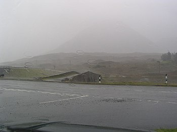 English: A rather damp Sligachan old bridge on...