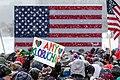 A supporter of Senator Amy Klobuchar holds an Amy Klobuchar sign at a rally where Klobuchar announced her 2020 presidential bid (40090515193).jpg