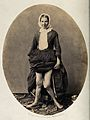 A woman standing; a full length view from the front, in whic Wellcome V0029430.jpg