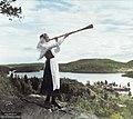 A young Swedish women playing a birch trumpet c.1930. (48091219423).jpg