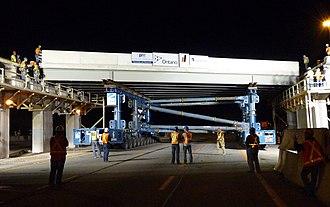 Aberdeen Avenue - Self-propelled modular transporters moving Aberdeen Bridge span into place.