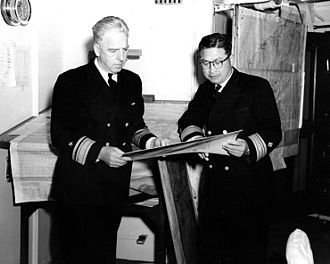 History of the Republic of Korea Navy - Rear Admiral Sohn Won-yil discussing Korean War operations with Rear Admiral A.E. Smith, USN
