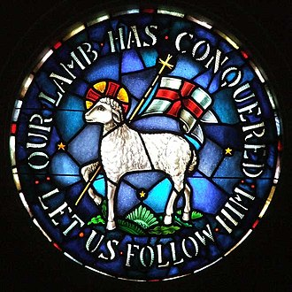 Moravian Church - Church emblem featuring the Agnus Dei. Stained glass at the Rights Chapel of Trinity Moravian Church, Winston-Salem, North Carolina, United States