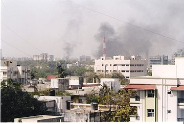 The skyline of Ahmedabad filled with smoke as buildings and shops are set on fire by rioting mobs Ahmedabad riots1.jpg