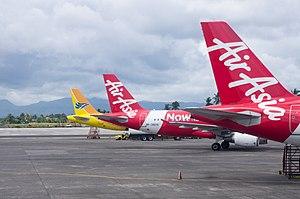 Kalibo International Airport - Air Asia and Cebu pacific planes at Kalibo Airport.