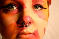 Amy has facepaint and a pierced septum.jpg