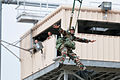 An Indian Army paratrooper exits a 34-foot training tower at the 82nd Airborne Division's Advanced Airborne School in 2013.jpg