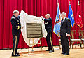"Army Gen. Martin E. Dempsey, left, chairman of the Joint Chiefs of Staff, and National War College Commandant Army Brig. Gen. Guy ""Tom"" Cosentino unveil a door placard to honor retired Air Force Lt. Gen. Brent 150113-D-HU462-075c.jpg"