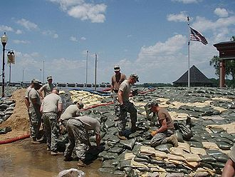 Clarksville, Missouri - Soldiers of the Missouri Army National Guard sandbag the Mississippi River, June 2008.