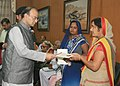 Arun Jaitley handing over the additional ex-gratia to the next of kin of battle casualties from the Army Battle Casualties Welfare Fund, which is contributed by concerned citizens, in New Delhi (1).jpg