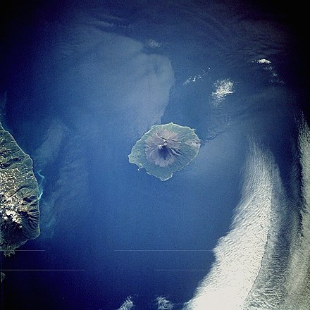Atlasov Island -- northernmost and highest island of the Kurils, viewed from space (southwest-up image) Atlasov island.jpg