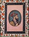 Aurangzeb Bahadur holding an iris (6124502565).jpg