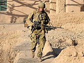Australian Army soldier armed with a FN MAG machine gun in Afghanistan during 2010 - cropped