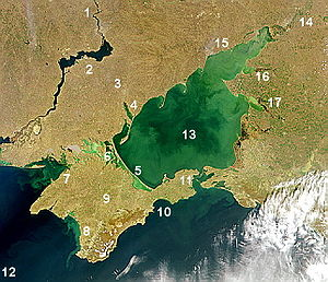 Sea of Azov - Satellite image of Sea of Azov. The shallow Sea of Azov is clearly distinguished from the deeper Black Sea. Numbers: 1. Dnieper River, 2. Kakhovka Reservoir, 3. Molochna River, 4. Molochny Liman, 5. Arabat Spit, 6. Sivash lagoon system, 7. Karkinit Bay, 8. Kalamitsky Bay, 9. Crimea, 10. Fedosiysky Bay, 11. Strait of Kerch, 12. Black Sea, 13. Sea of Azov, 14. Don River (Russia), 15. Taganrog Bay, 16. Yeysk Liman, 17. Beisug Liman