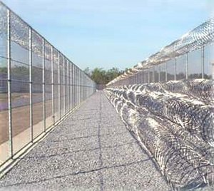 Concertina wire - Concertina wire can be a feature of prisons.