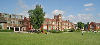 Bablake School - Main school building in the centre, with the English, Drama and Music block and the Language block to the right of the photo; Sixth Form block and Science Quadrant to the left