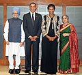 Barack Obama and the First Lady Mrs. Michelle Obama with the Prime Minister, Dr. Manmohan Singh and his wife Smt. Gursharan Kaur, at a dinner hosted by the Prime Minister, in New Delhi on November 07, 2010.jpg