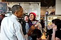 Barack Obama looks at a selfie taken with restaurant staff at Charmington's cafe in North Baltimore, Md., Jan. 15, 2015.jpg