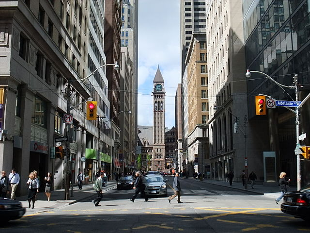 Bay Street in Downtown Toronto By mark.watmough from Edinburgh, UK (Toronto street  Uploaded by Skeezix1000) [CC BY 2.0 (https://creativecommons.org/licenses/by/2.0)], via Wikimedia Commons