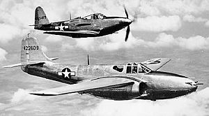 Air Force Systems Command - Bell P-59A (S/N 44-22609, the first United States jet fighter) and a P-63 Kingcobra (S/N 42-69417) in flight, 1944.