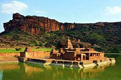 Bhutanatha temple complex at Badami, 7th century, with the open hall (11th century) extending to the lake.