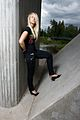 Blond woman in black clothing under cement pilars 04.jpg