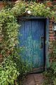 Blue door and portal in Walled Garden at Goodnestone Park Kent England.jpg