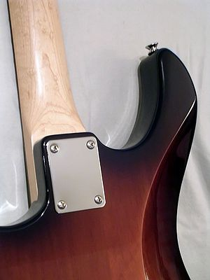 Bolt-on neck - Neck joint with a four-screw plate on a Yamaha Pacifica 112 electric guitar
