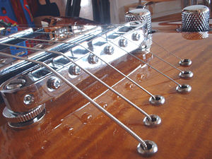 """Electric guitar - Tune-o-matic with """"strings through the body"""" construction (without stopbar)"""