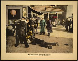 Broken Blossoms - Lobby card for the film, showing the early scene in which drunken Western sailors fight on a street in China