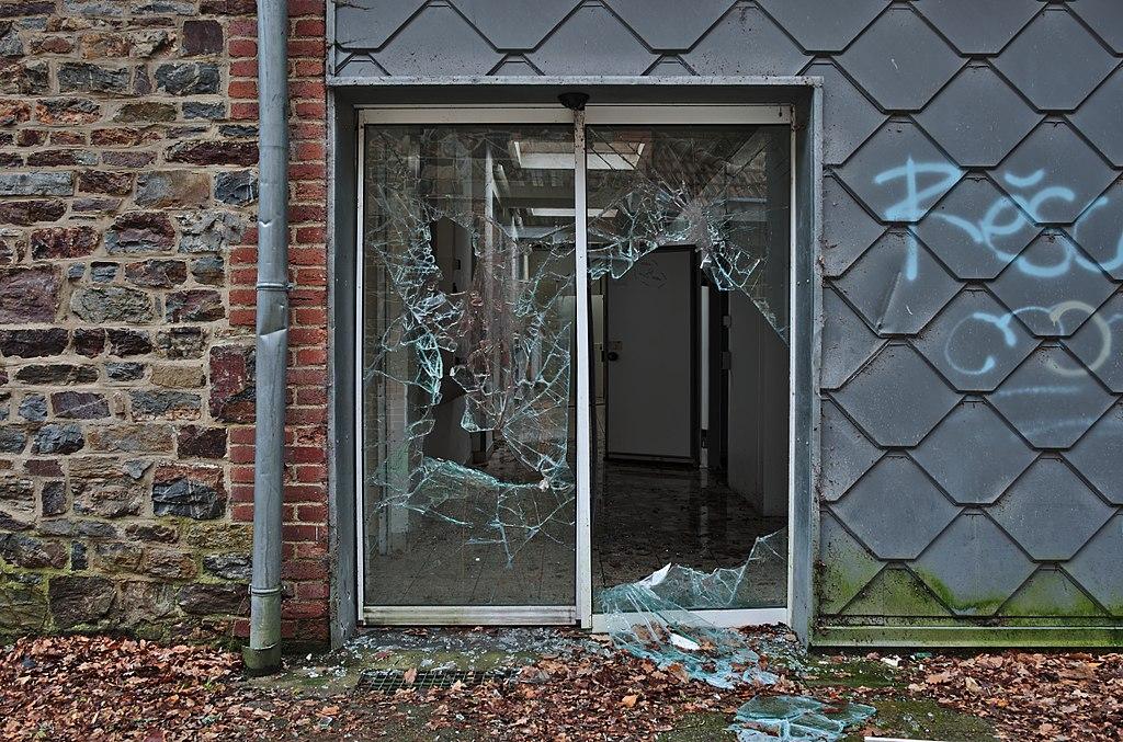 Filebroken Glass Door Leading To The Kitchen In Sanatorium Du Basil