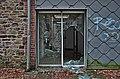Broken glass door leading to the kitchen in Sanatorium du Basil, Stoumont, Belgium (DSCF3564-hdr).jpg