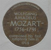 "Circular plate inscribed: ""London County Council: Wolfgang Amadeus Mozart 1756–1791 composed his first symphony here in 1794"""