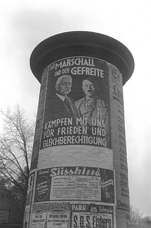 "Reichstag (Nazi Germany) - Election poster for Hindenburg and Hitler in November 1933. It reads: ""The Marshall and the Corporal fight with us for peace and equality"""