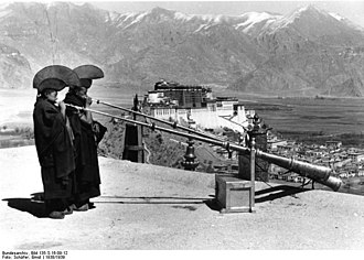Music of Tibet - Monks playing dungchen, Tibetan long trumpets, from the roof of the Medical College, Lhasa, 1938