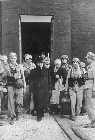 Gran Sasso raid - Mussolini leaving the Hotel