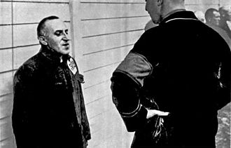 "Ossietzky in the Esterwegen concentration camp, ""Ossietsky - A man speaks with a hollow voice from across the border"", 1934 Bundesarchiv Bild 183-R70579, Carl von Ossietzky im KZ.jpg"